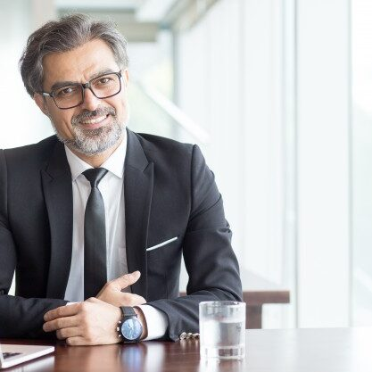 cheerful-businessman-eyeglasses-office_1262-3710-square